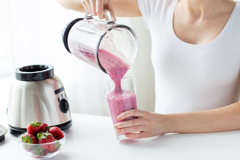woman drinking diet shake