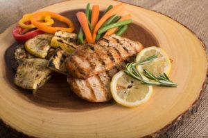 plate of grilled chicken and veggies