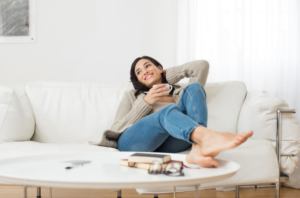 woman relaxing on a white couch