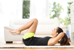 woman doing a sit up in living room