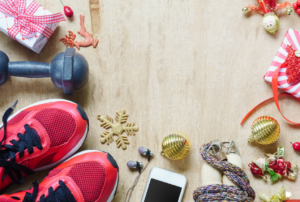 sneakers and weights with christmas ornaments