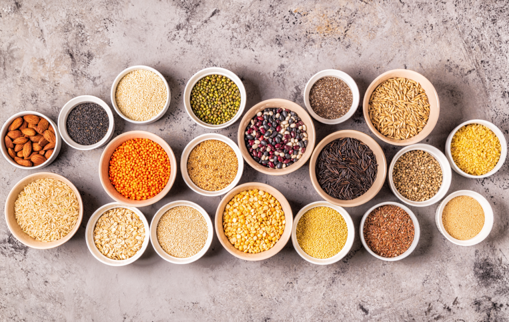 whole grains, beans and legumes, seeds and nuts, top view.